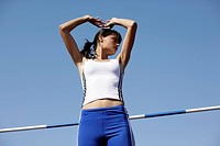 Woman making high jump