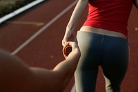 Women passing a relay baton