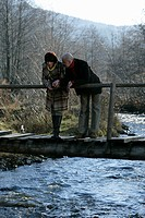 Mature couple standing on a bridge