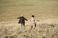 Mature couple walking down a hill