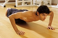 Darkhaired Man doing Press_Ups _ Sportiness _ Gymnastics