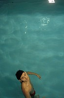 Darkhaired Man in a Swimming_Pool _ Sports _ Leisure Time