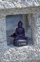 Metallic Buddha_Figure in a little House made of Stone _ Sculpture _ Object _ Religion