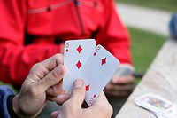 Hands holding two play cards (thumbnail)