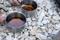 Two Tin cups with tea