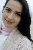 Young brownhaired Woman with Cardigan at the Beach - Holiday - Temperature (thumbnail)