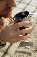 Man with Freckles holding a metallic Cup _ Beverages _ Leisure Time