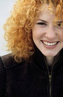 Portrait of a young Woman with strawberry_blonde Curls _ Hair