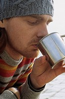 Man with Freckles drinking from a metallic Cup _ Beverages _ Leisure Time
