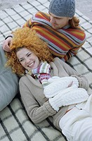 Young Woman with red Curls lying in the Lap of her Boyfriend _ Relationship _ Togetherness _ Season