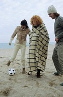 Three Friends playing Football at the Beach _ Fun _ Game _ Season _ Coldness
