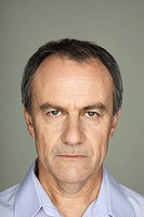 Mature man with serious expression on face, portrait