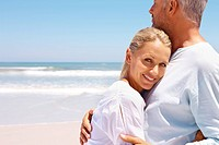 Portrait of loving aged couple together at the beach