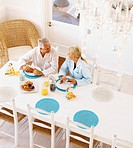 A healthy retired old couple having breakfast in the morning