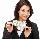 Portrait of an excited young business woman holding money isolated on white background