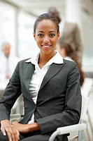 Portrait of a professional African American business woman sitting on a chair