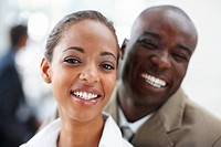 Image of an African American business man and woman smiling together