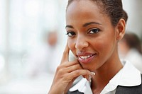 Closeup photo of an elegant African American business woman smiling confidently