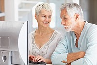 Senior couple working on a computer together