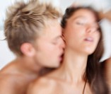 Blurred image of an intimate young couple indulging in sexual intercourse