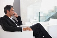 Image of a contemplative business man speaking on mobile phone
