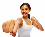 Smiling young woman with a closed fist, isolated over white