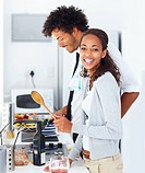 Portrait of a smiling young couple preparing food together at home