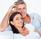 Closeup portrait of a happy couple relaxing together over white background