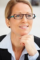 Closeup portrait of a mature happy business woman wearing spectacles