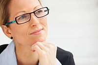 Portrait mature business woman wearing spectacles looking at copyspace
