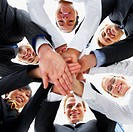 Business people hands on top of each other showing unity