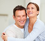 Closeup portrait of laughing young couple enjoying together