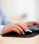 Closeup of senior man hands using computer mouse