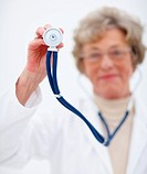 Closeup portrait of elderly female doctor with stethoscope