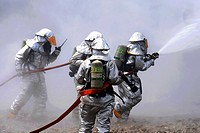 Firefighters battle the smoke during a live fire response exercise July 21, 2010, at the Combat Readiness Training Center in Alpena, Mich  The firefig...