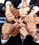 Group of multiracial hands together showing thumbs up sign