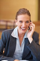 A professional business woman speaking using a cellular phone