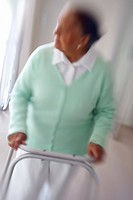Blurred image of a senior woman walking on a Zimmer frame