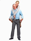 Portrait of cheerful elderly couple enjoying while in a playful mood on white background