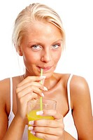 Beautiful young woman sipping juice with a straw on white background