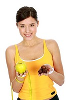 Woman weighing up fruit or chocolates