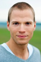Closeup portrait of a handsome young guy isolated outdoors