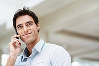 Handsome young guy using a mobile phone with copyspace