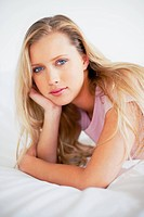 Portrait of a cute Caucasian woman relaxing on bed
