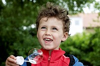 A boy blowing soap bubble
