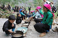 H´mong women taking communal lunch during funeral in a village around Sa Phin,Ha Giang province,Northern Vietnam,southeast asia