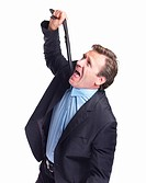 Business Frustration _ Mature man pulling necktie to choke himself on white background