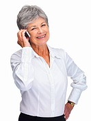 Happy senior business woman using cellphone with copyspace over white background