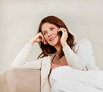 Pretty smiling middle aged brunette using cellphone