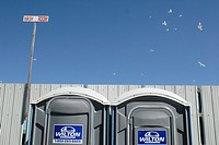Canada, Ontario, Keady. July 2010. Humourous photo of portable toilets and a flock of flying gulls